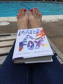 Reading a book in summer by the pool